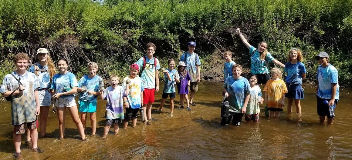 Campers standing in the river
